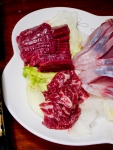 """""""Basashi"""", or horse sashimi, is a delicacy which Kumamoto prefecture is famous for.  By the way, the sashimi on the right is fish, not horse."""